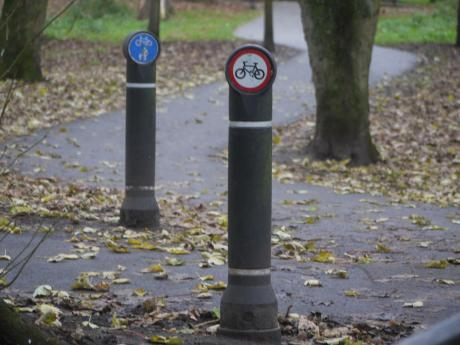 Two posts in Beddington Park. Foreground cycling prohibited, background shared for those on foot and on bicycle